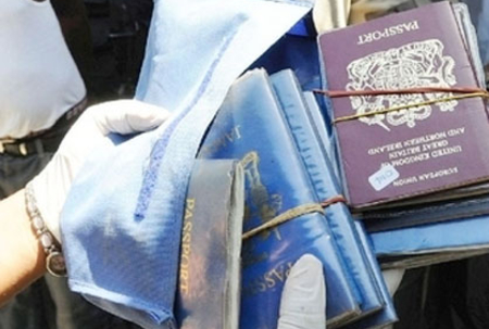 Passports seized  in visa raid