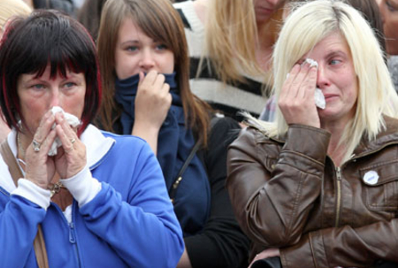 Thousands mourn victims of gunman