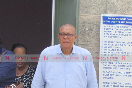Lawyer charged with stealing