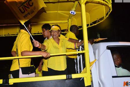 Kamla passes through PNM rally