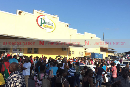 Crowds gather outside supermarkets