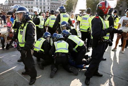 London police break up COVID protest