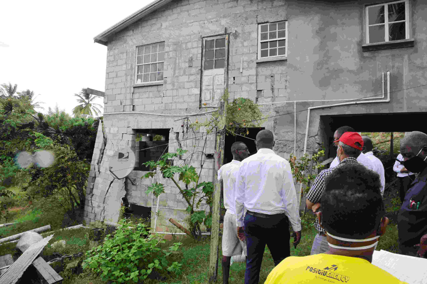 Government officials look at slipping homes
