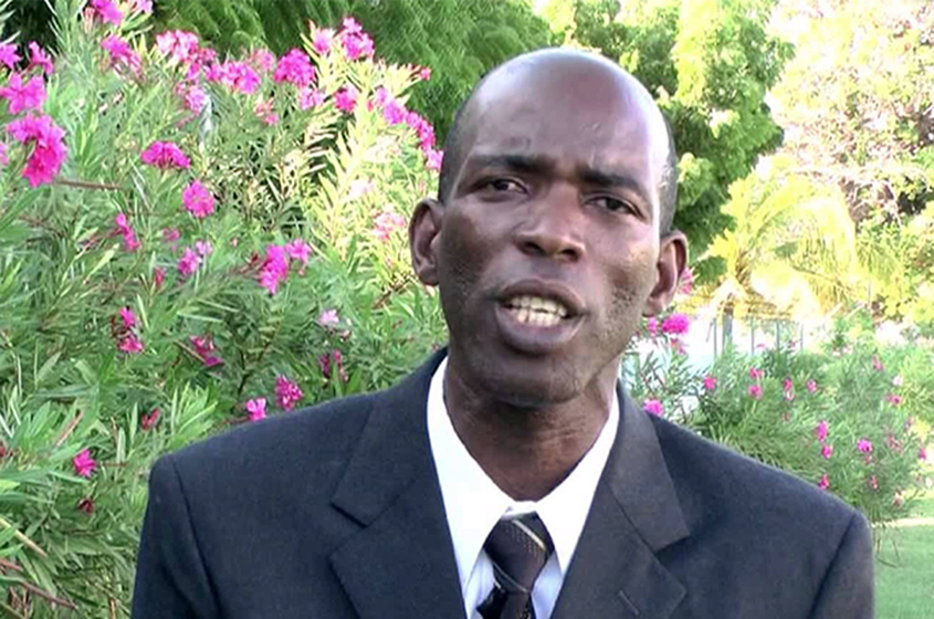 Opposition Leader in Grenada chains himself to table