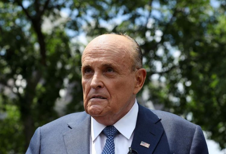 Justice Department executes warrant on Giuliani's home, office