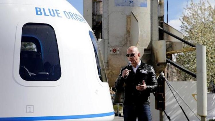 Bezos to fly to space next month