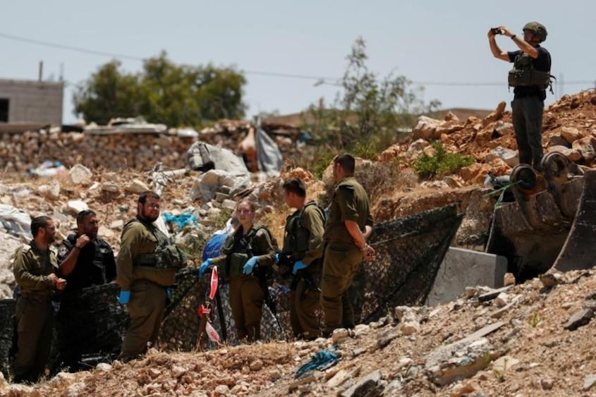 Palestinian woman shot after attacking Israeli troops – army