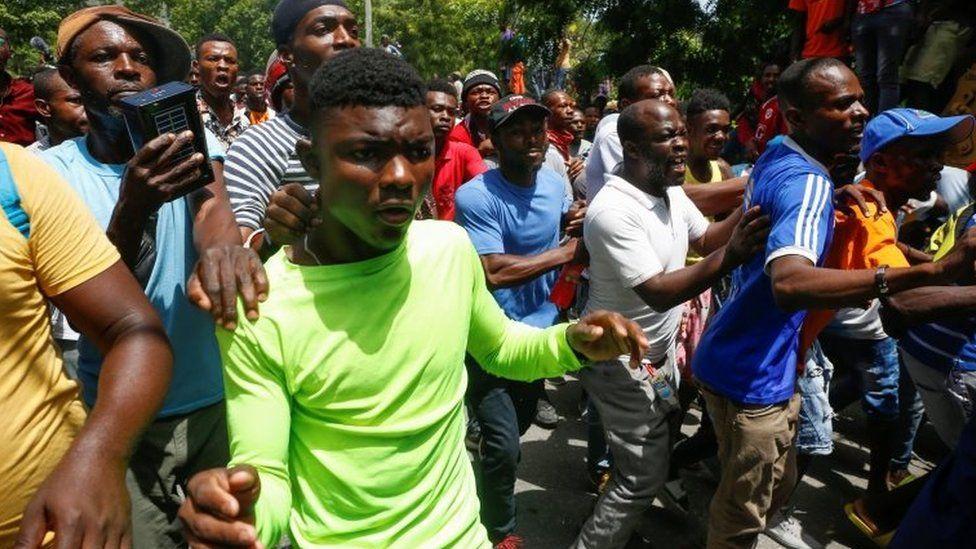 Moise update: Haiti officials seek masterminds after 'suspected assassins' detained
