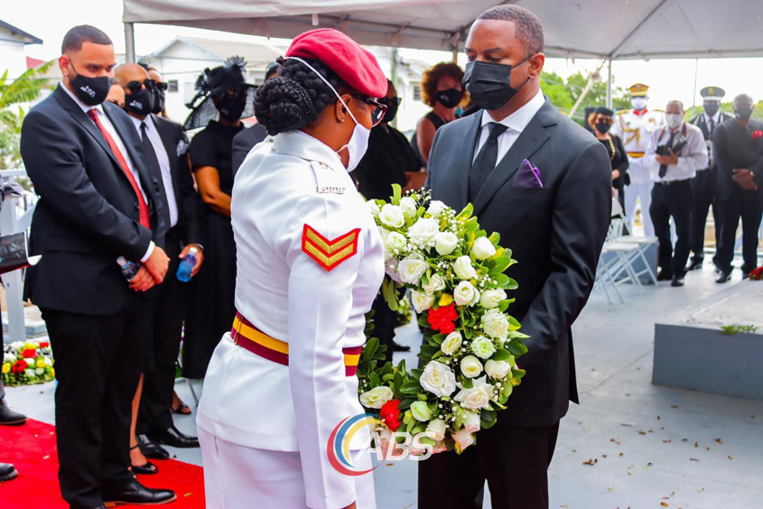 Abrahams laid wreath at Sir Lester's funeral