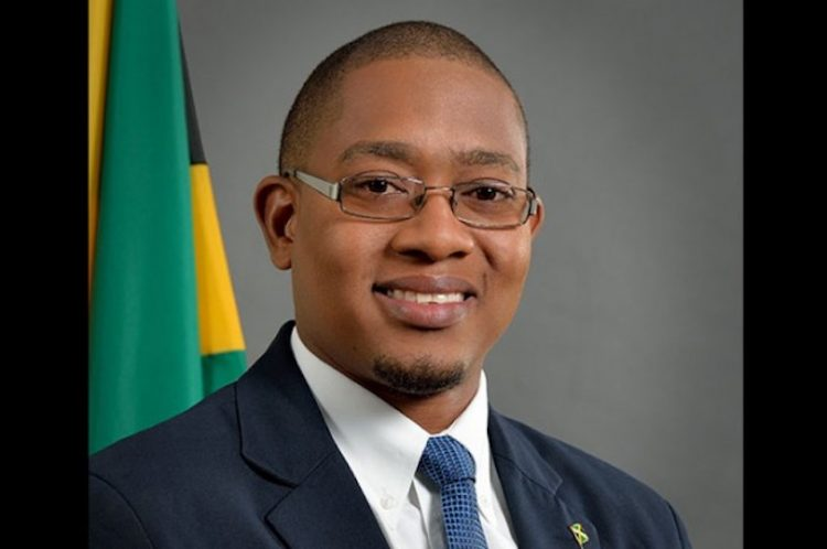 Jamaica agriculture minister resigns over mask-less appearance at social