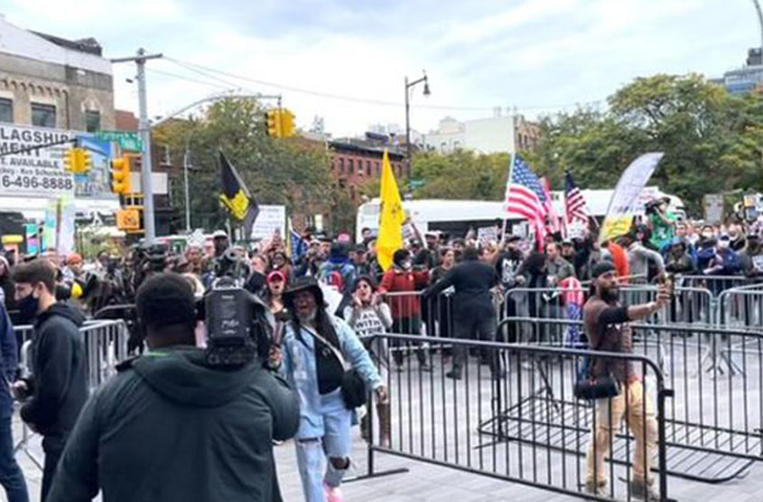 Anti-vaccine demonstrators show support for Kyrie Irving in New York